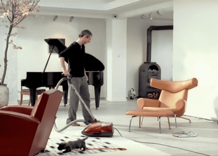 """Miele """"Sucking Good"""" ad using the stereotype where in a couple the man is the fool"""